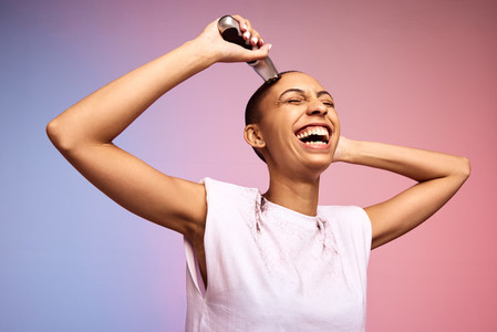 Bold and liberated woman shaving her head