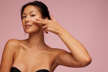 Asian woman doing a skin treatment