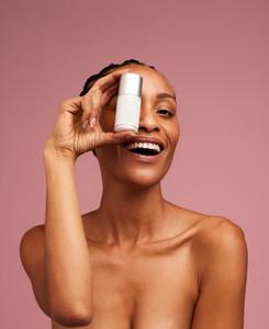 Woman holding a skincare cream