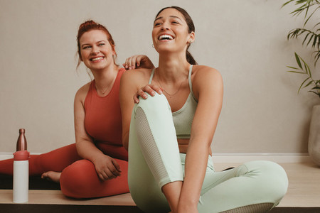 Cheerful women relaxing during a workout session