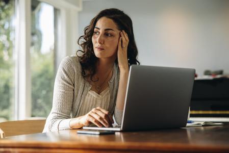 Female sitting at her work desk