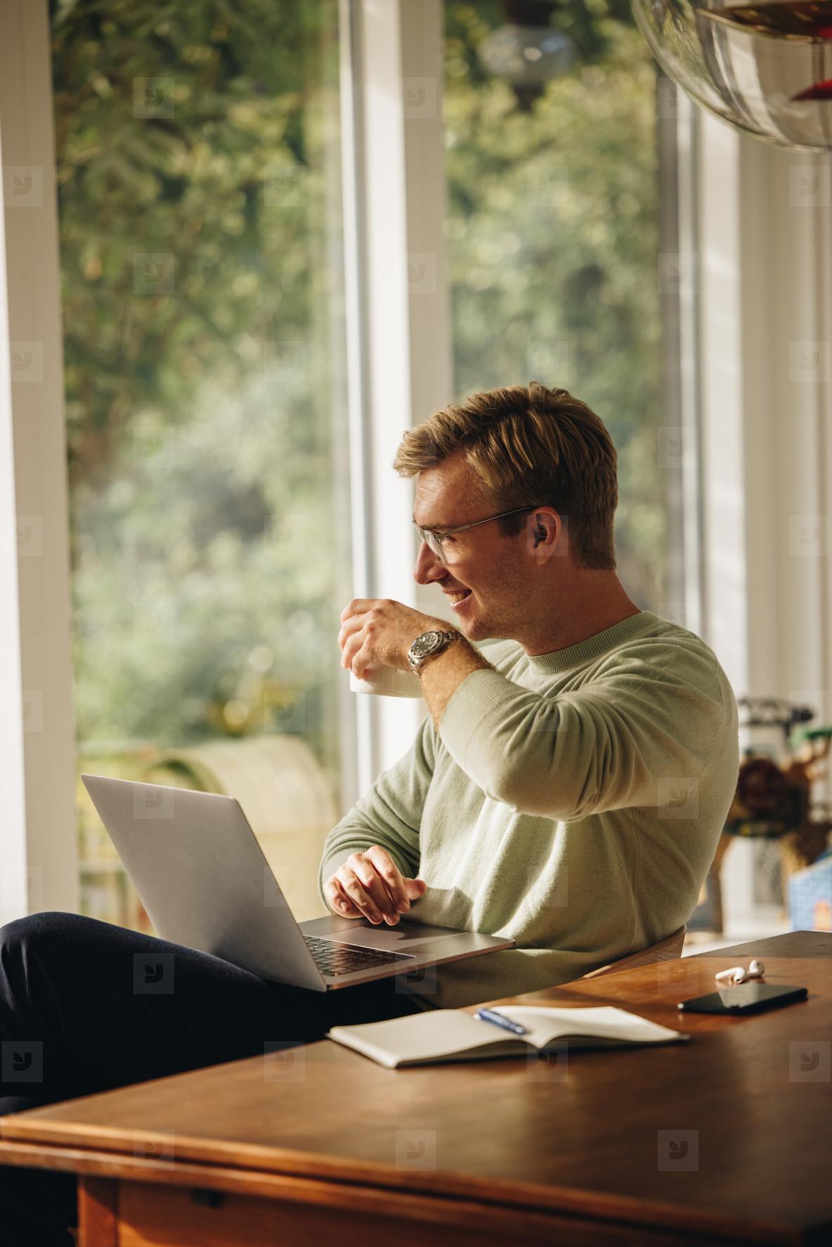 Man having coffee while working