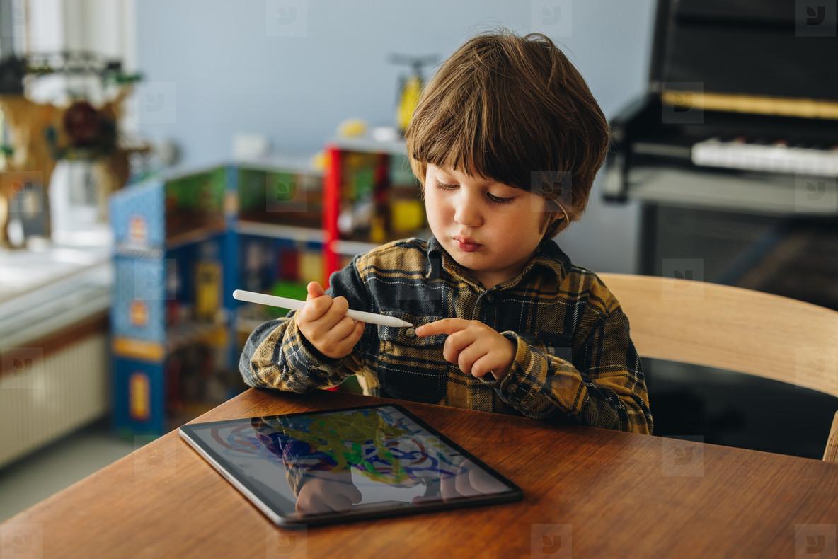 Innocent boy using tablet
