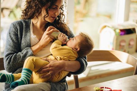 Newborn baby drinking milk