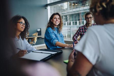 Confident businesswoman in boardroom meeting