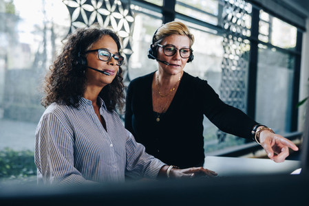 Business women working together in office