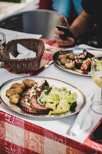 Traditional portuguese grilled octopus  boiled potato and cabbage in cafe