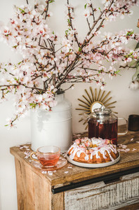 Gluten free bundt cake and tea under almond blooming branches