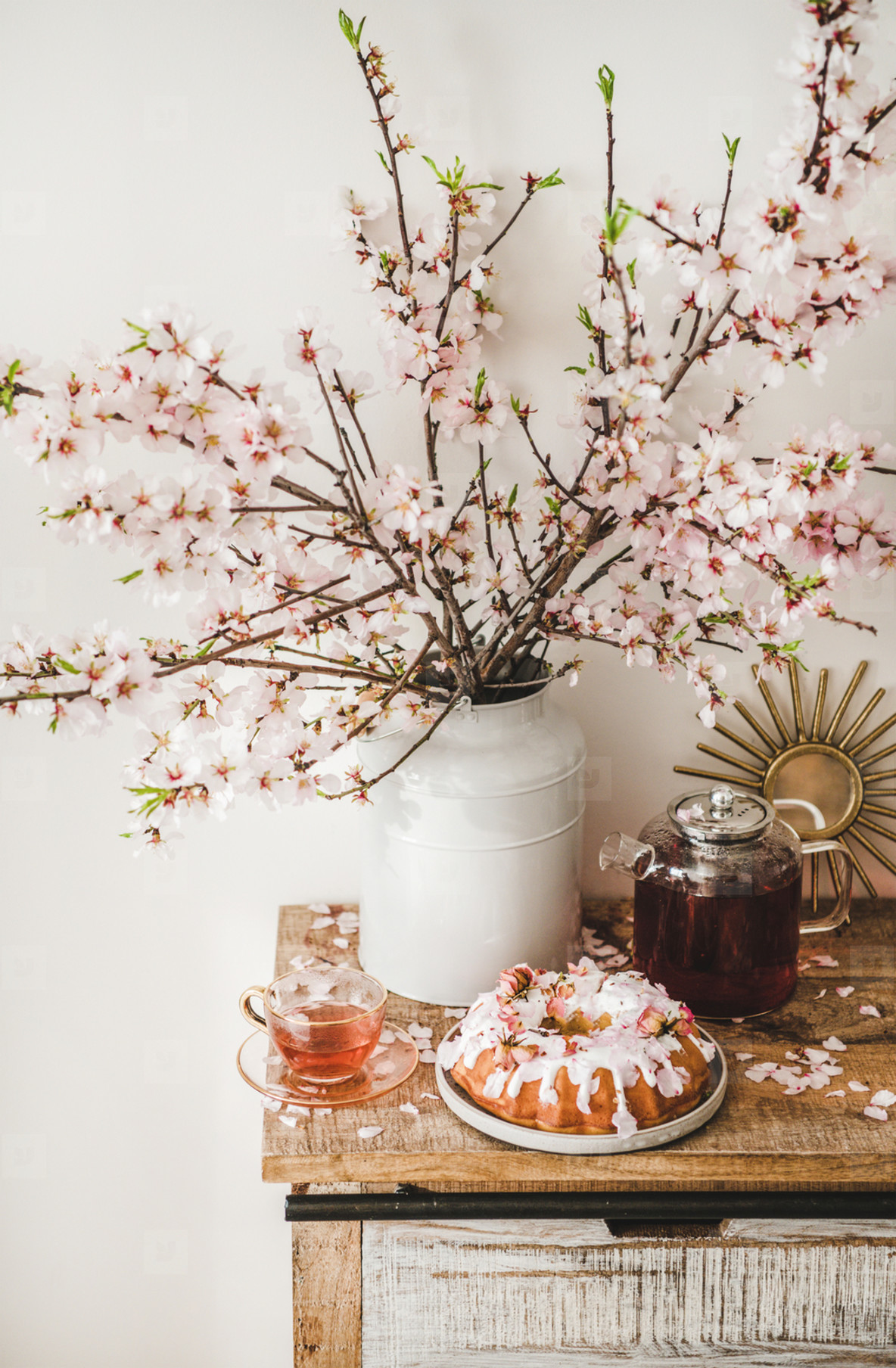 Gluten free bundt cake and tea under blooming branches