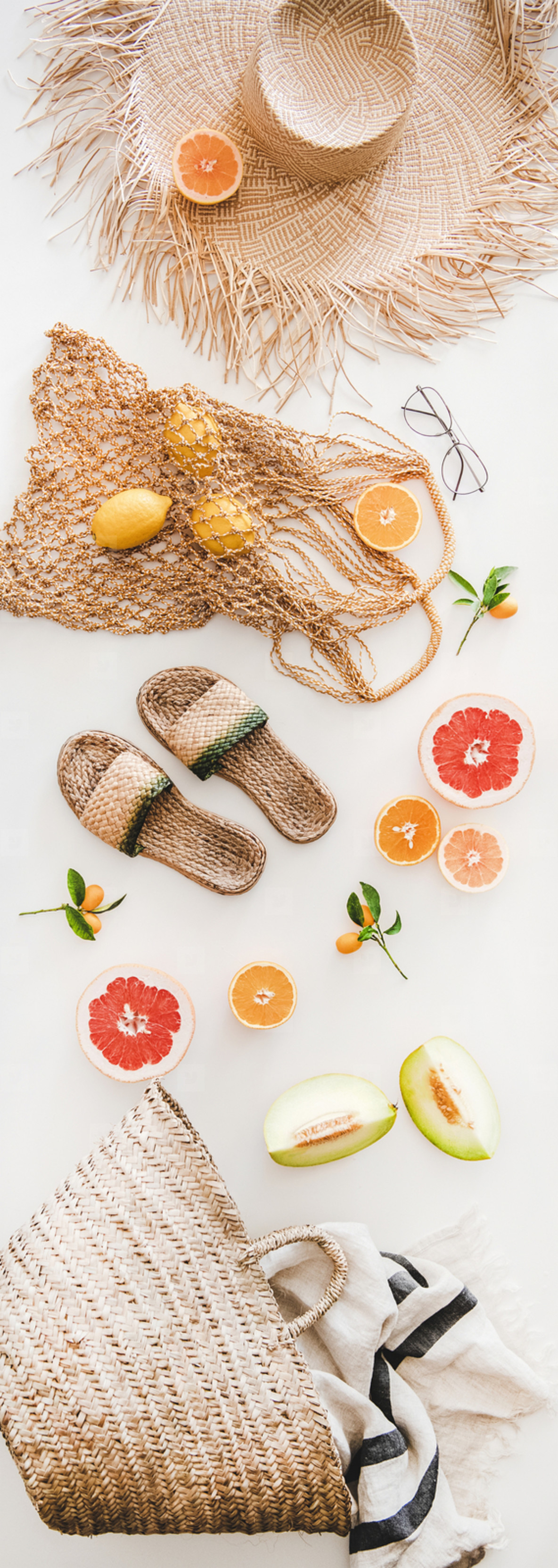 Summer layout with feminine accessories and fresh fruits  vertical composition