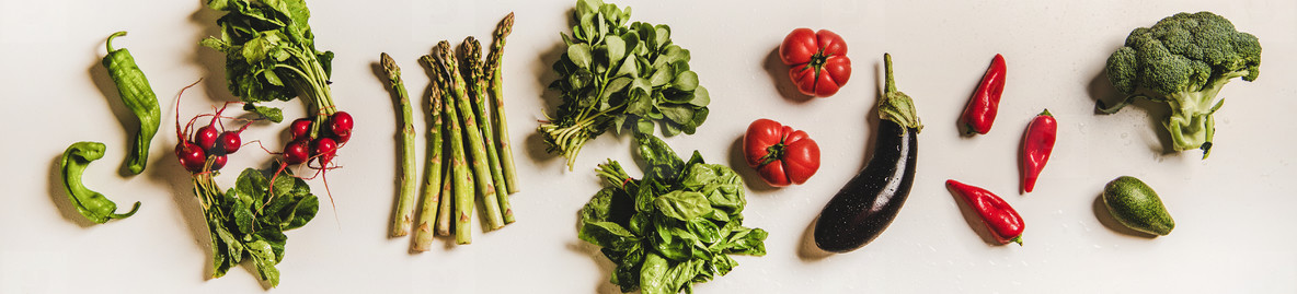 Flat lay of various summer fresh vegetables layout  wide composition