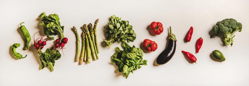 Various summer fresh vegetables layout over plain white background