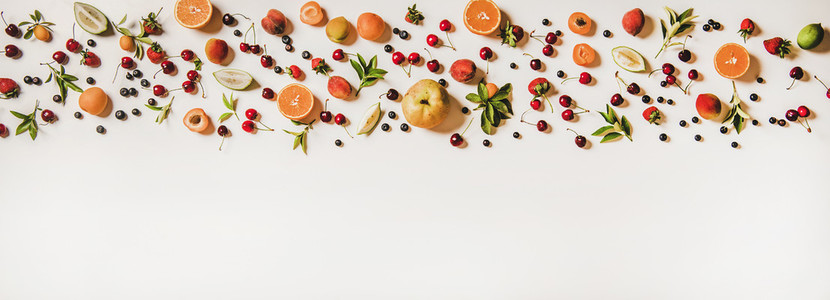 Fresh summer fruit and berries variety layout over white background