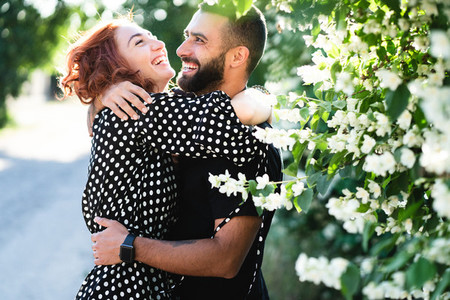 loving guy and girl posing together on camera