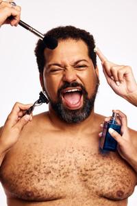 Many hands grooming beard man