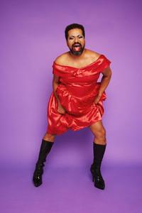 Gender queer male performing on purple background