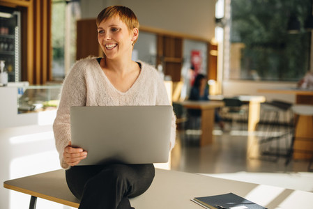 Freelancer with laptop in coworking space