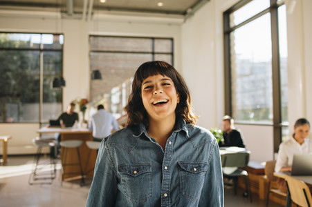 Smiling female freelancer in co working space
