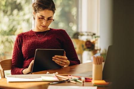 Female designer using tablet