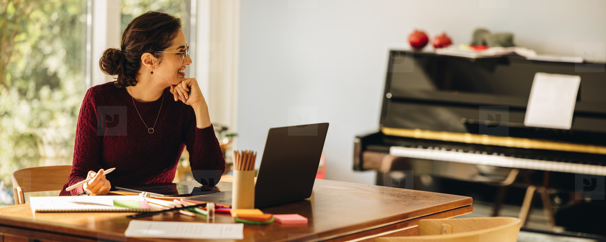 Woman designer working at home