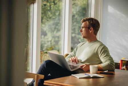 Man sitting with laptop
