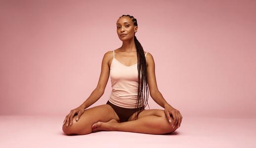 Portrait of mature black woman in underwear