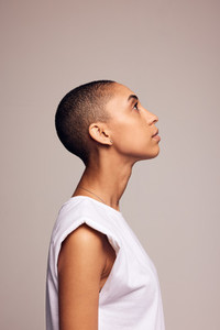 Woman in casuals with shaved head