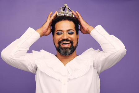 Portrait of drag queen with crown on head