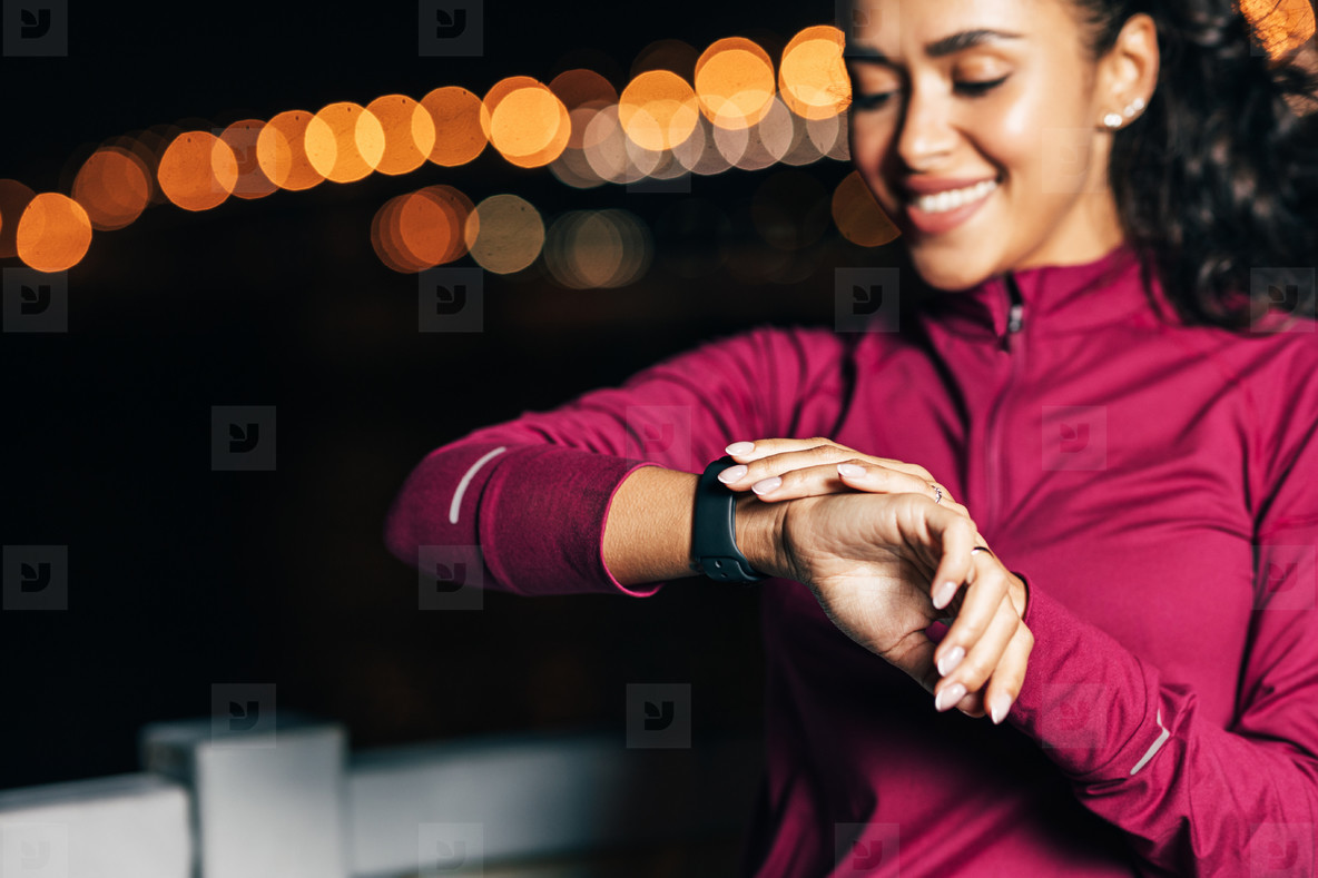 Close up of a sportswoman checking smartwatch on her wrist