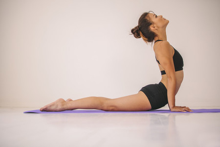 Woman practicing Cobra pose yoga asana