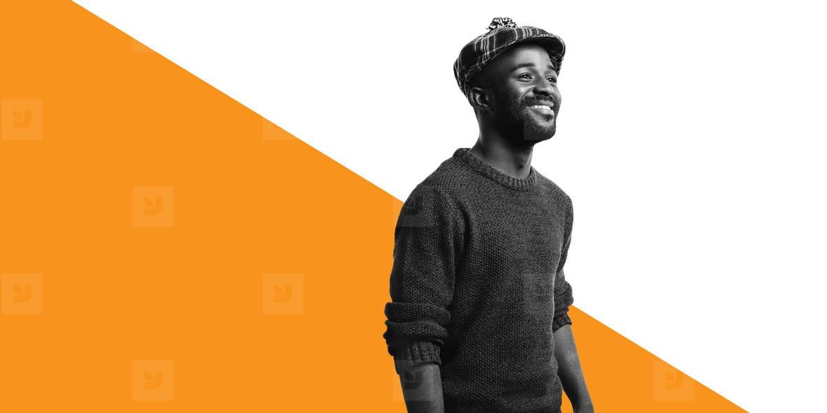 Portrait of smiling male in tartan cap