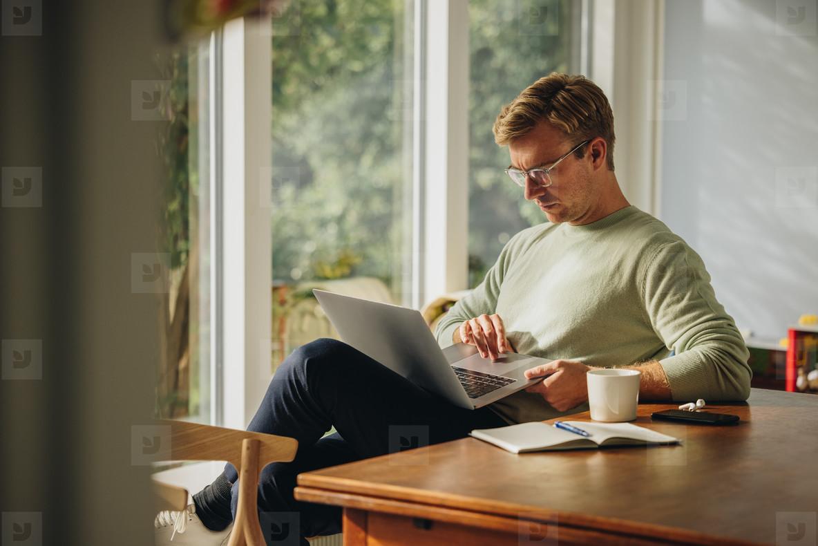 Man sitting using laptop