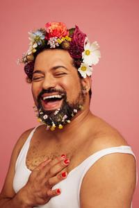 Smiling queer wearing makeup
