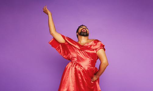 Drag queen singing on purple background