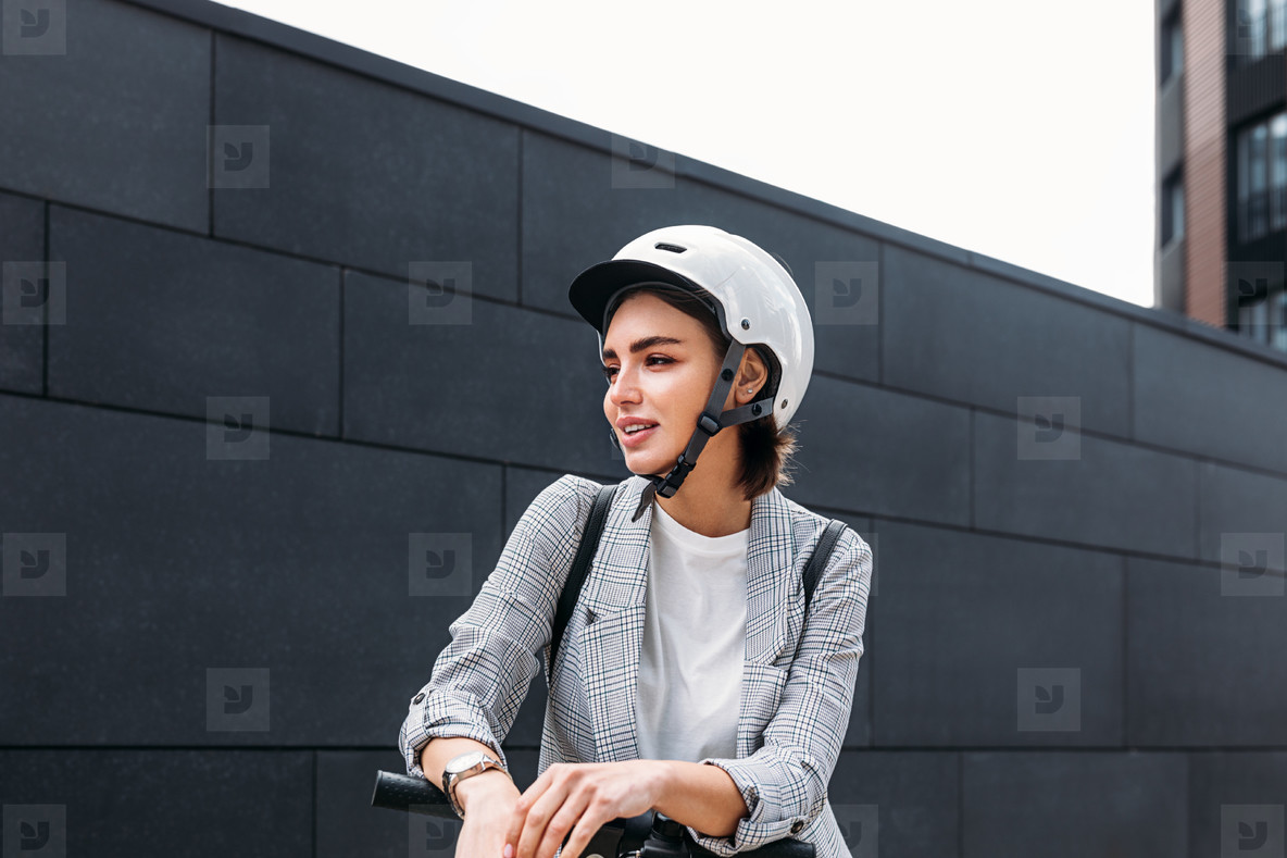 Portrait of young woman wearing safety driving helmet
