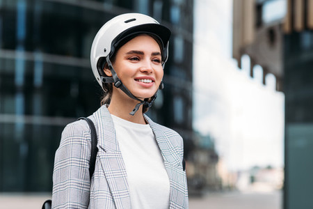Portrait of a beautiful smiling businesswoman with a white safety helmet on head