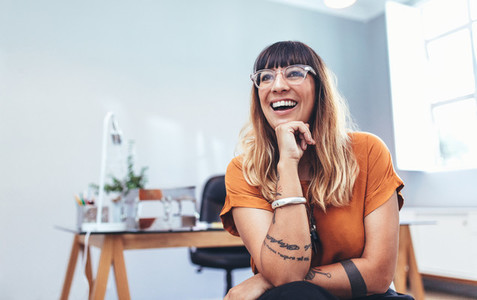 Portrait of a smiling businesswoman sitting in office