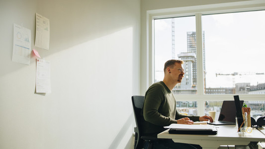 Executive working at desk in office