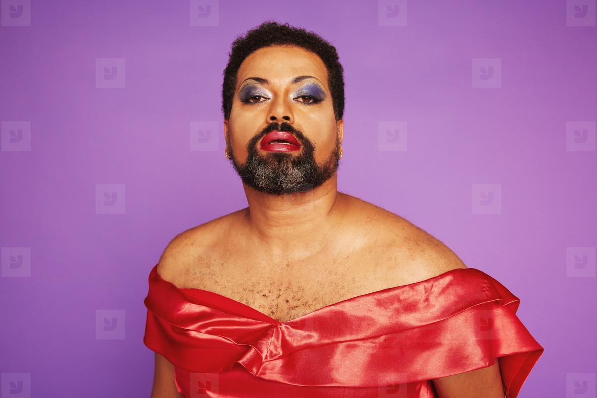 Elegant drag queen on purple background
