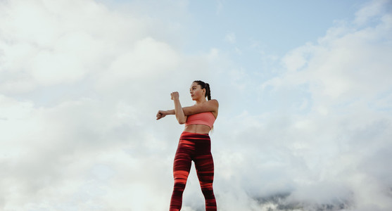 Female athlete doing stretching workout outdoors