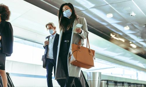 Travelers at airport terminal post pandemic lockdown