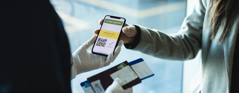 Tourist check in using immunity passport app in mobile phone for