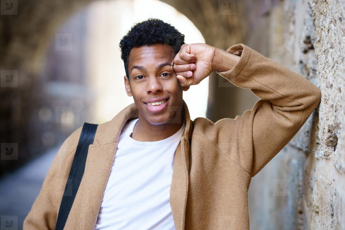 Young black man looking at camera outdoors