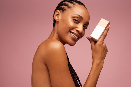Woman showing skincare product