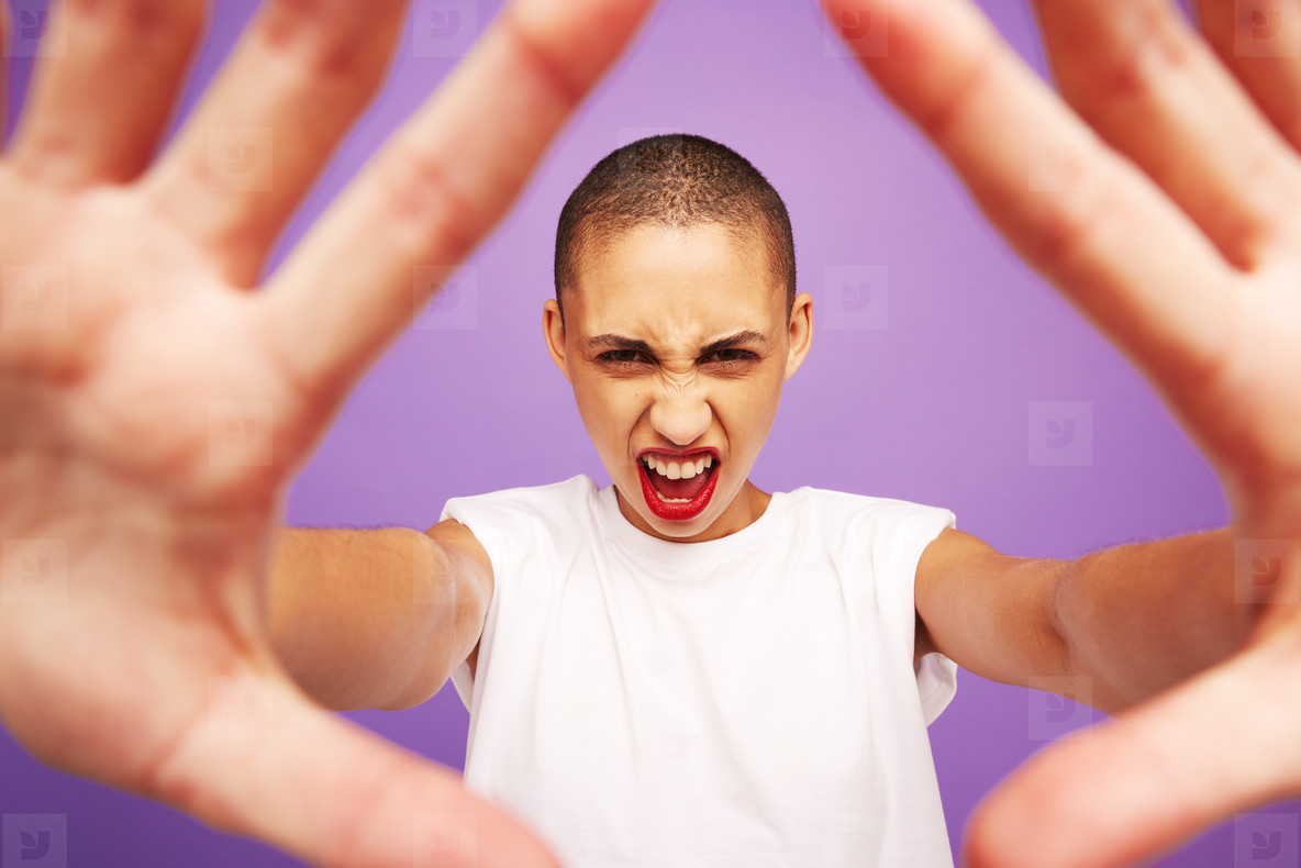 Portrait of a excited female with hands in front