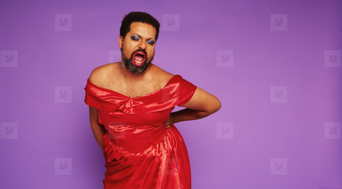 Male in drag singing in theater