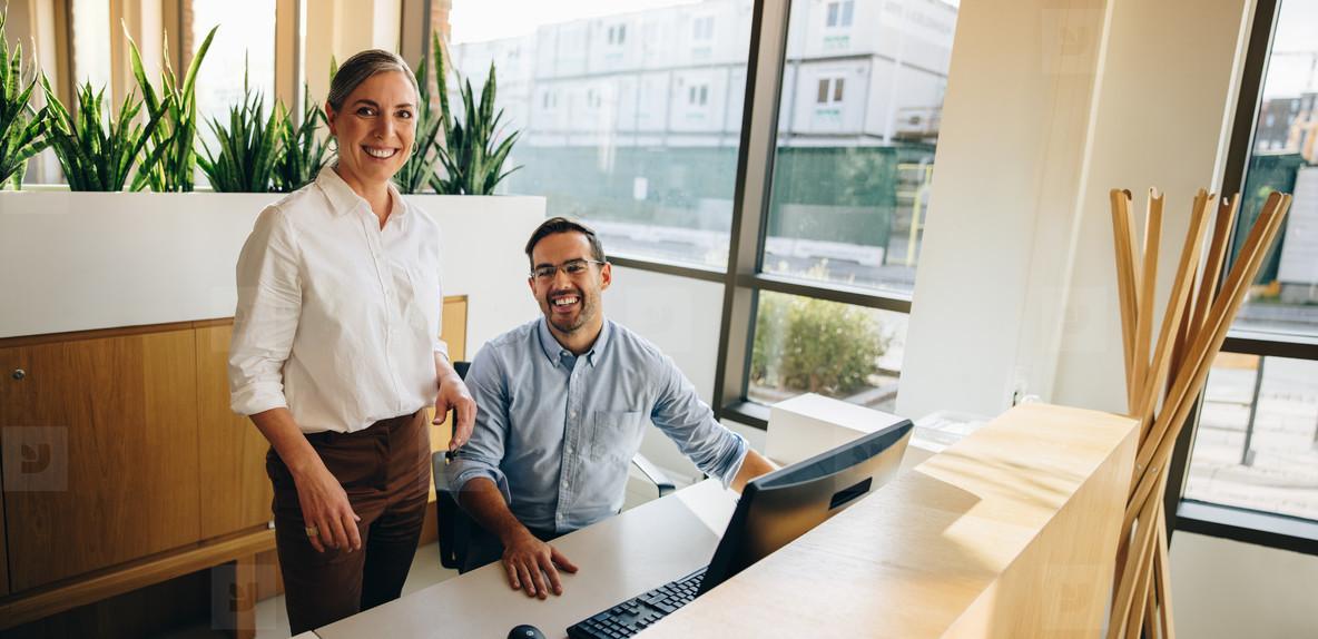 Business executives looking at camera