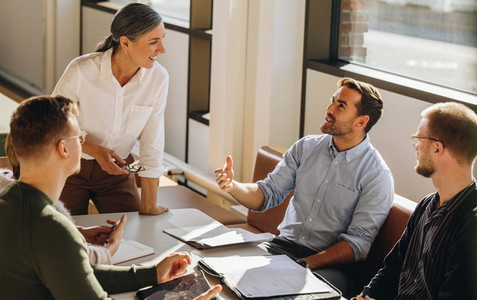 Executive talking to female entrepreneur during meeting
