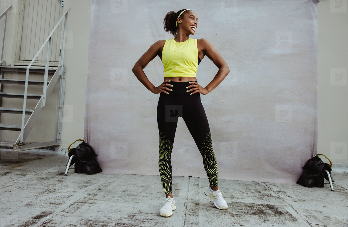African woman in fitness wear on rooftop