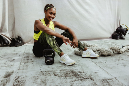 Portrait of a female athlete relaxing after workout